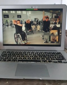 Photo of a Mac with screen and keyboard. People working out in a gym and people working out in a Zoom-meeting.