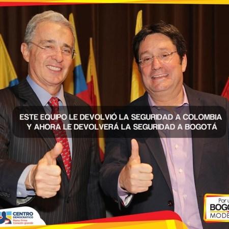 Alvaro Uribe y Francisco Santos