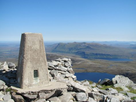 Trig point, Ben Hope, looking across Ben Loyal to Morven on horizon