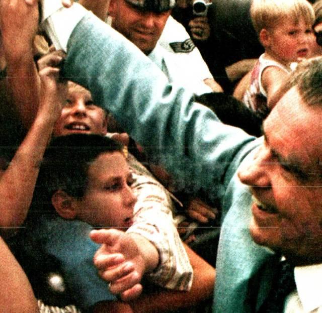 Nixon Campaigning - spent a fortune in cufflinks.