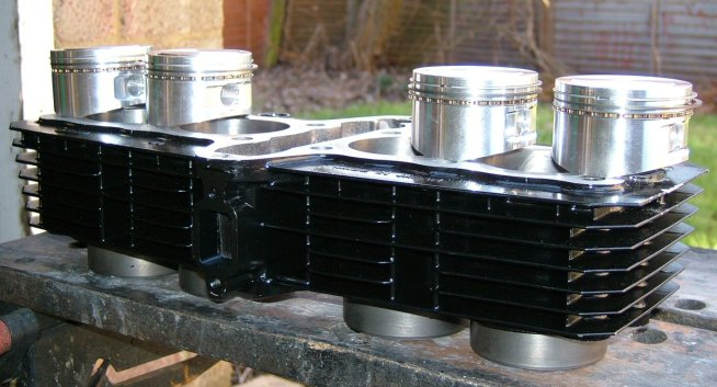 Refurbished cylinder block with new pistons