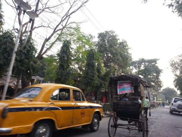 An Ambassador (taxi) and a cycle-rickshaw