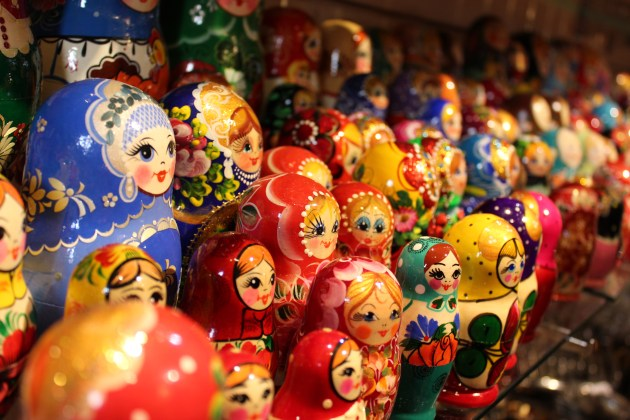 Matryoshka dolls gathered in a huddle
