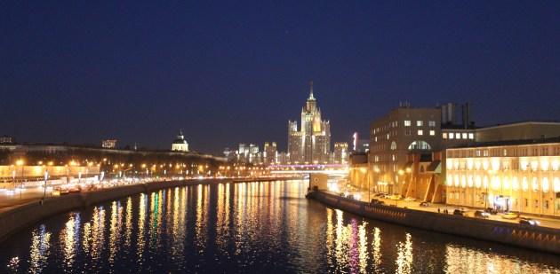 The glittering Moscva River at night