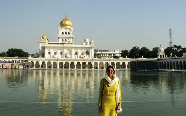 The majestic Guru Bangla Sahib Gurudwara throws its resplendent reflection in the pond