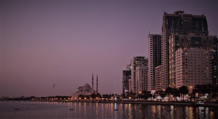 Sharjah's skyline glitters in the auburn evening
