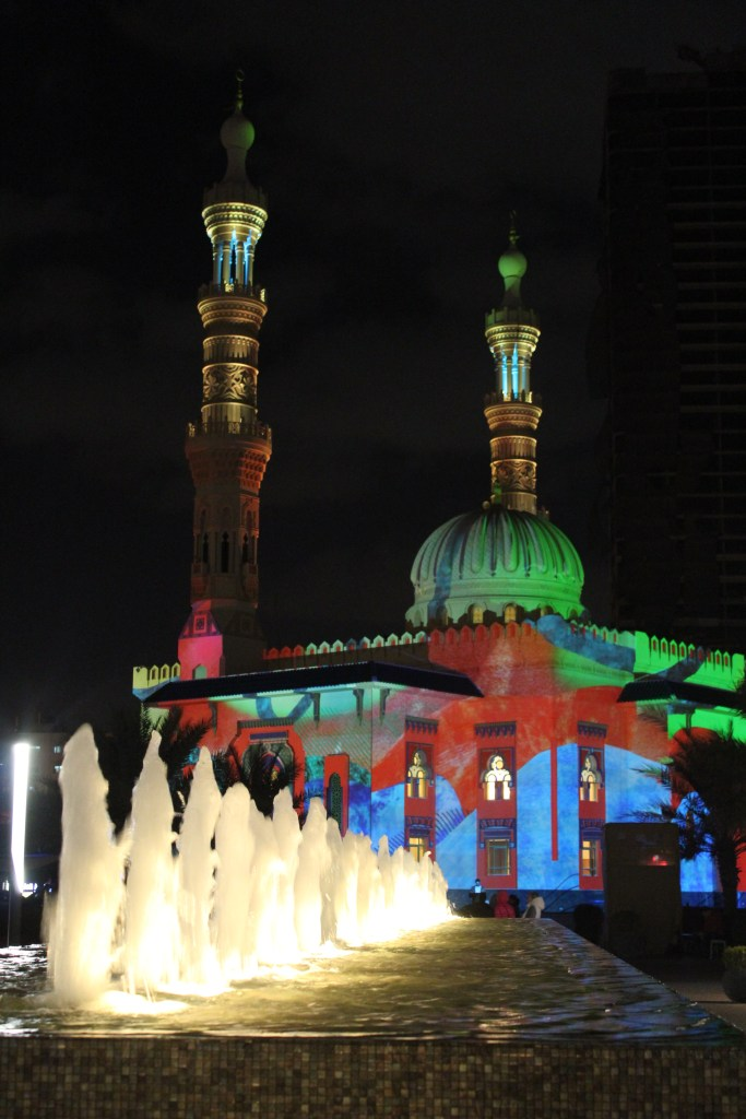 Al Qasba mosque is bathed in colours