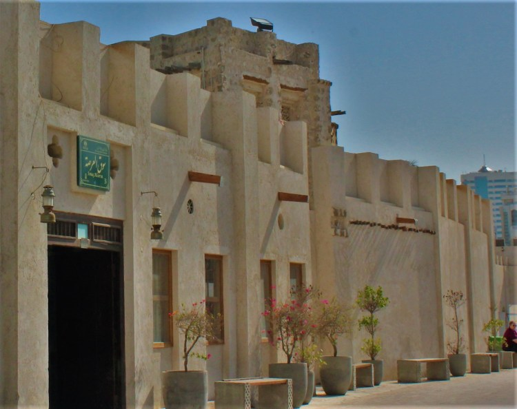 Souq Al-Arsa exudes old world charm with its stucco exterior.