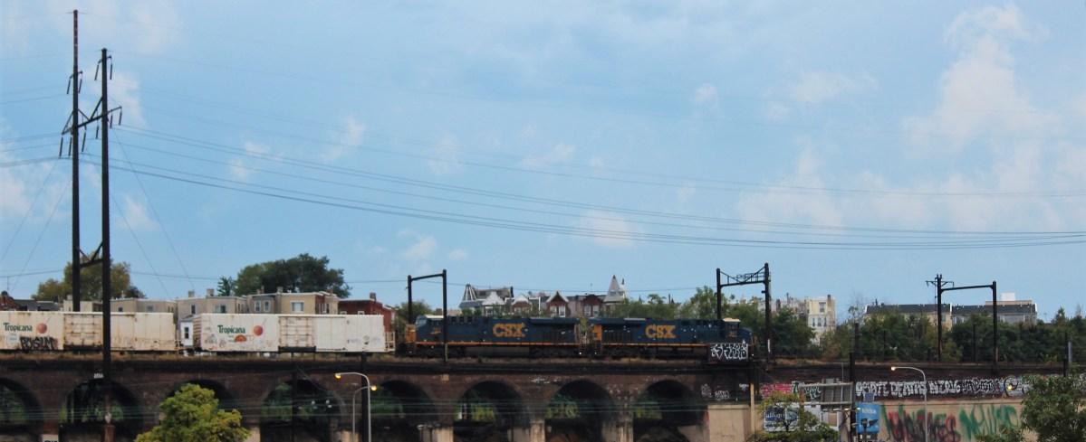 A train chugs across one of Philly's numerous bridges.