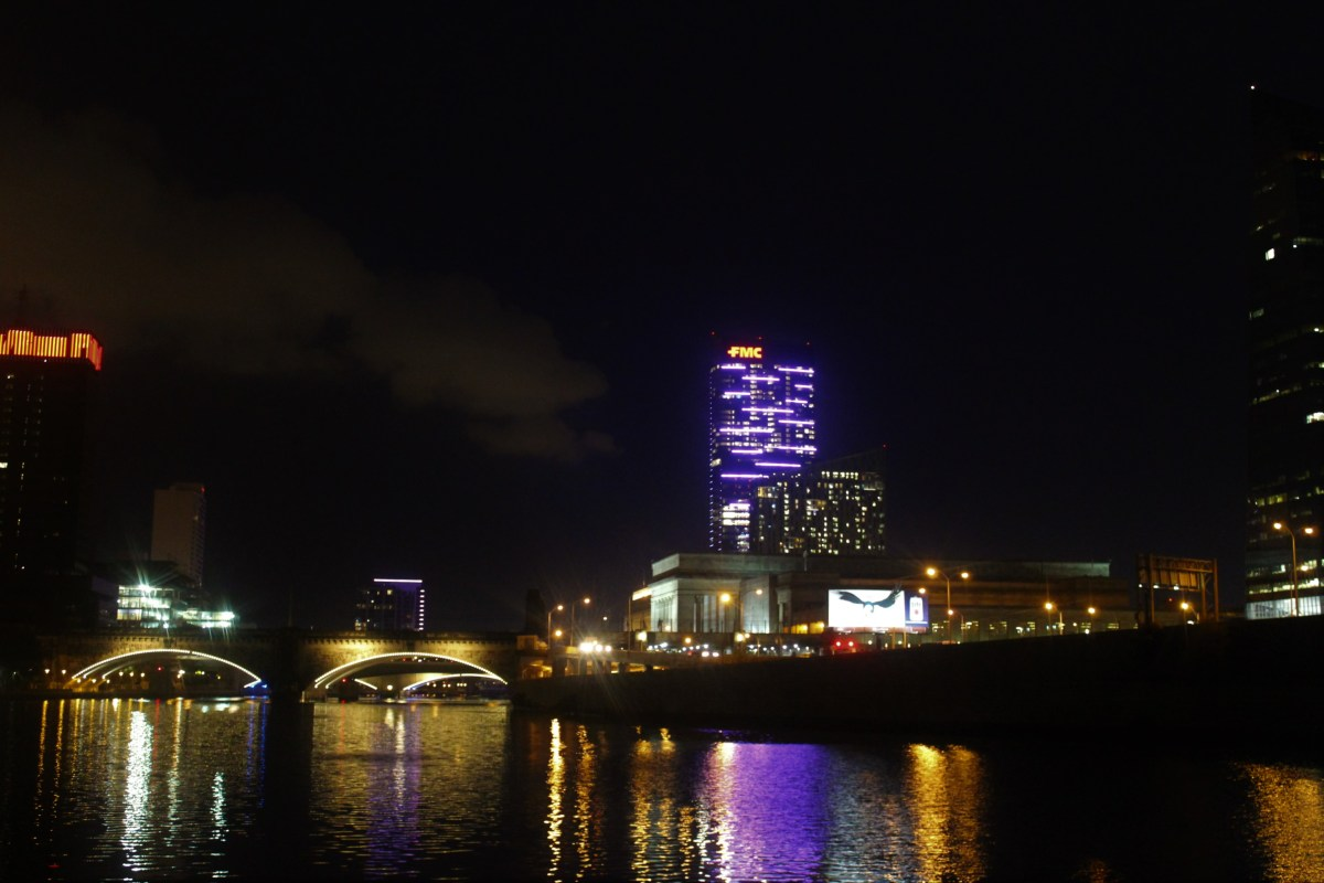By night, this city glows in the reflection of its neon-lit buildings and arched bridges.