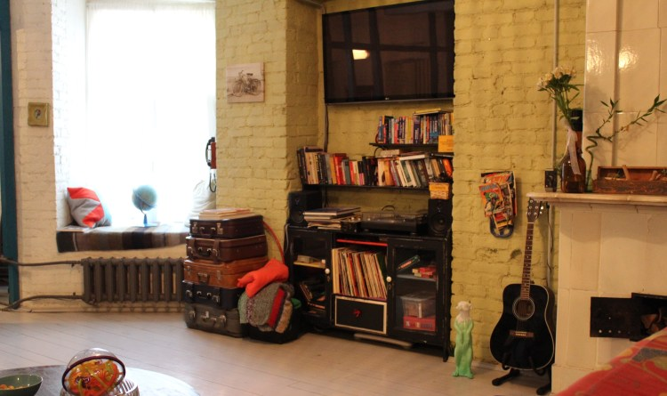 Traveling means exploring living rooms full of books and music.