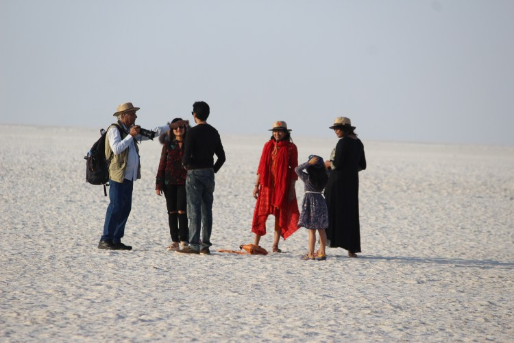 It's surprisingly easy to chat with a stranger when you need someone to take your picture. (In the great White Rann of Kutch)