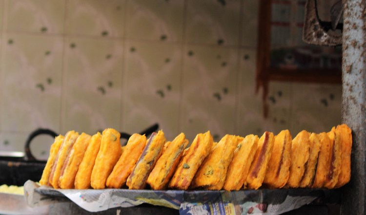 A stack of bread pakoras waiting to be devoured - at a roadside stall along Garhwal's national highway.