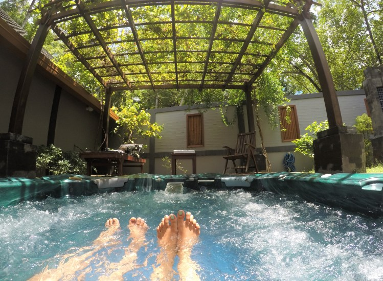 My husband and I enjoy our private jacuzzi in a secluded Japanese garden at the Paradise Island Resort, Maldives.