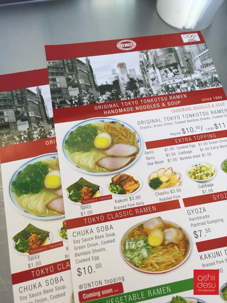 Photo Description: a picture of the menu which has the black and white image of Shibuya crossing with Shibuya 109 in the background.