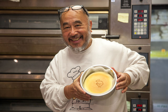 Photo Description: Uncle Tetsu dude himself holiding one of his cheesecakes.