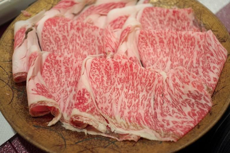 Photo Description: a plate of thinly sliced shimofuri Japanese wagyu that will be used for shabu shabu.