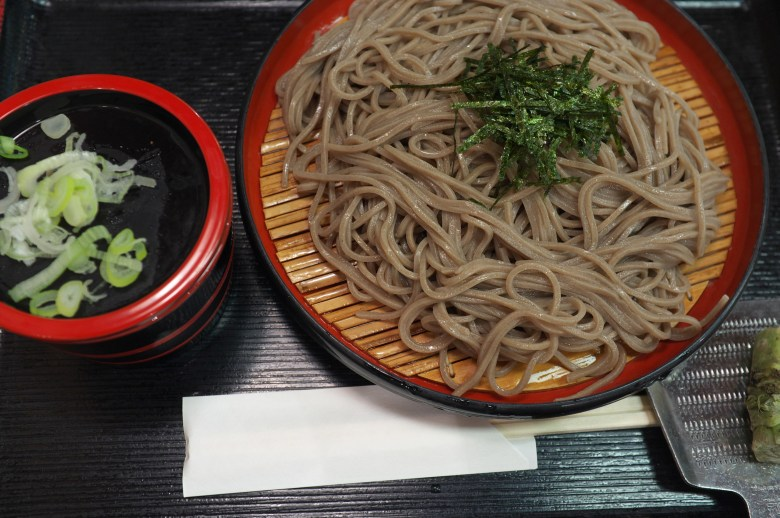 Photo Description: Soba noodles atop round plate which is called zaru.