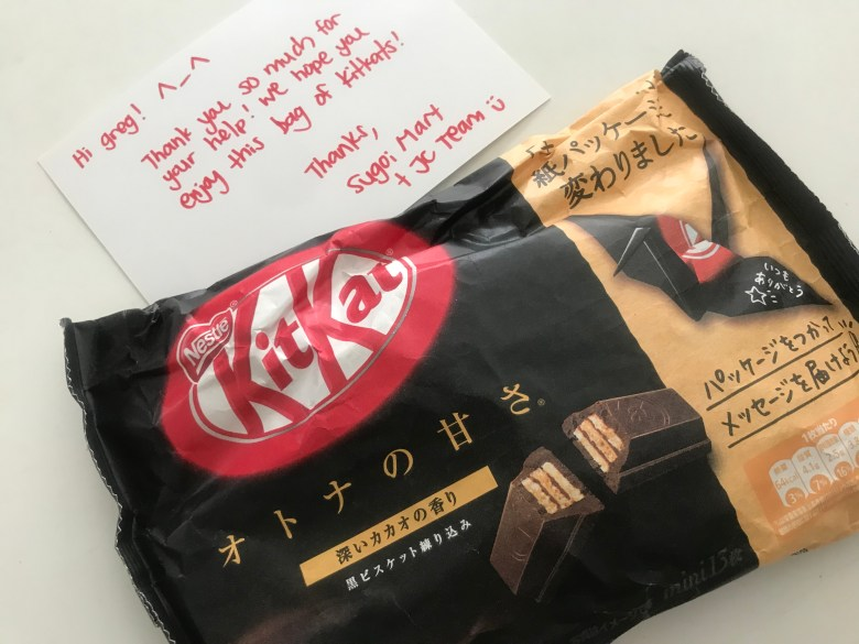 "Photo Description: the bribery I tool from Japan Crate for posting this content although I really want the ""toys."" (one bag of dark chocolate KitKats)."