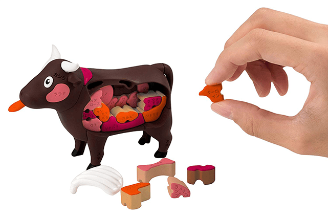 Photo Description: this plastic cow has all the various cuts of a cow.