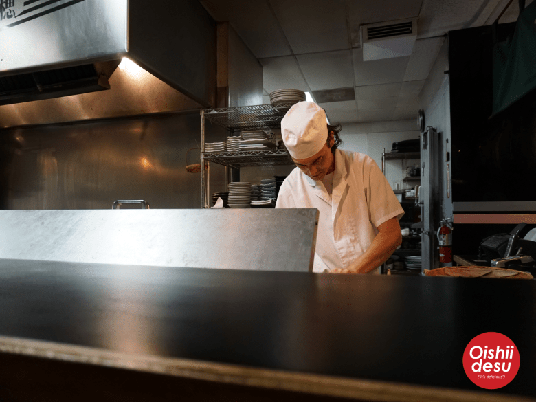 Photo Descriptions: a chef a Kappo Sui in orange county almost looks like ann American diner chef with his white hat and white shirt.