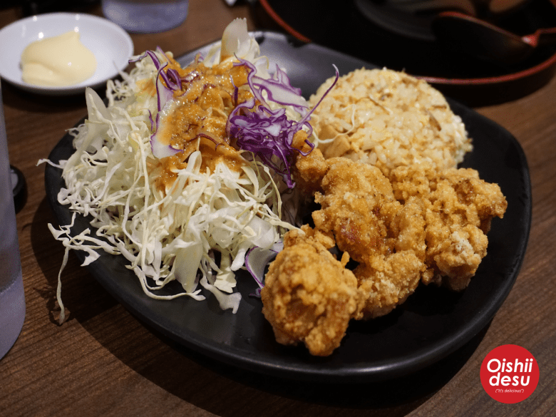 Photo Description: the karaage at Jidaiya Ramen, along with their sliced cabbage and a side of fried rice.