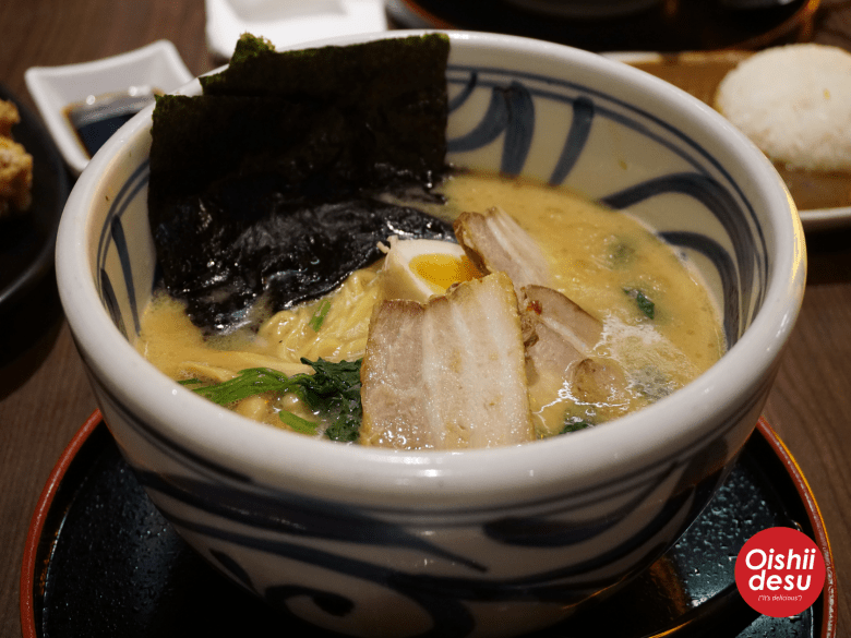 Photo Description: a shot of the tonkotsu ramen at Jidaiya ramen which consists of nori, hanjuku tamago, noodles, looks like three rather decently sized pieces of pork belly chashu, and the iconic spinach for iekei ramen.