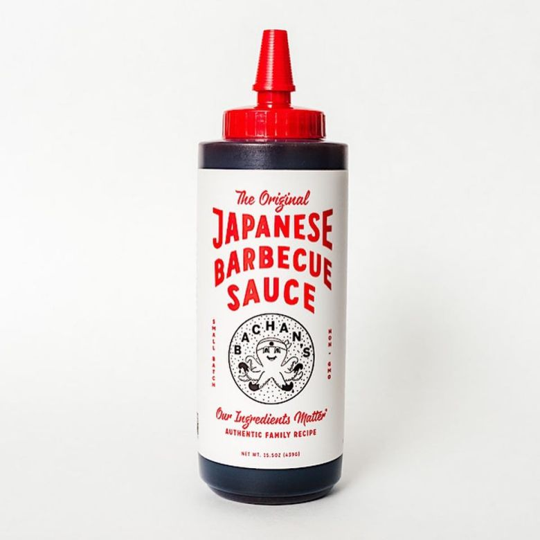 """Photo Description: a bottle of bachan's in a clear plastic bottle with a white label and the graphic and an octopus logo with the words """"Bachan's"""" concentric to the octops."""