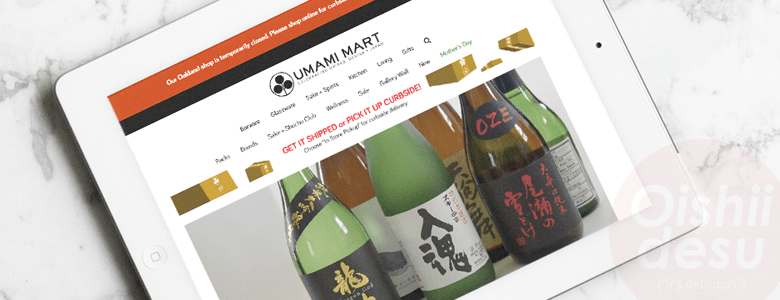 Photo Description: an iPad with a screenshot of umamimart.com. The main homepage includes and image of several of their sake products.