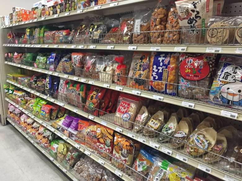 Photo Description: shelves of products of Japanese snacks line the shelves at Nakata Market in Las Vegas.