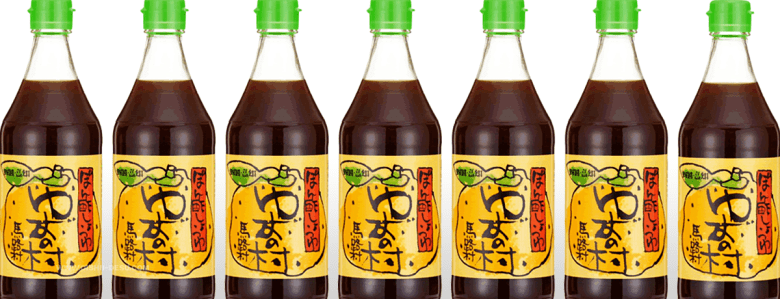Photo Description: a line of bottles with clear bottles, yellow labels, and a light green top is the packaging for Umaji Mura yuzu ponzu.