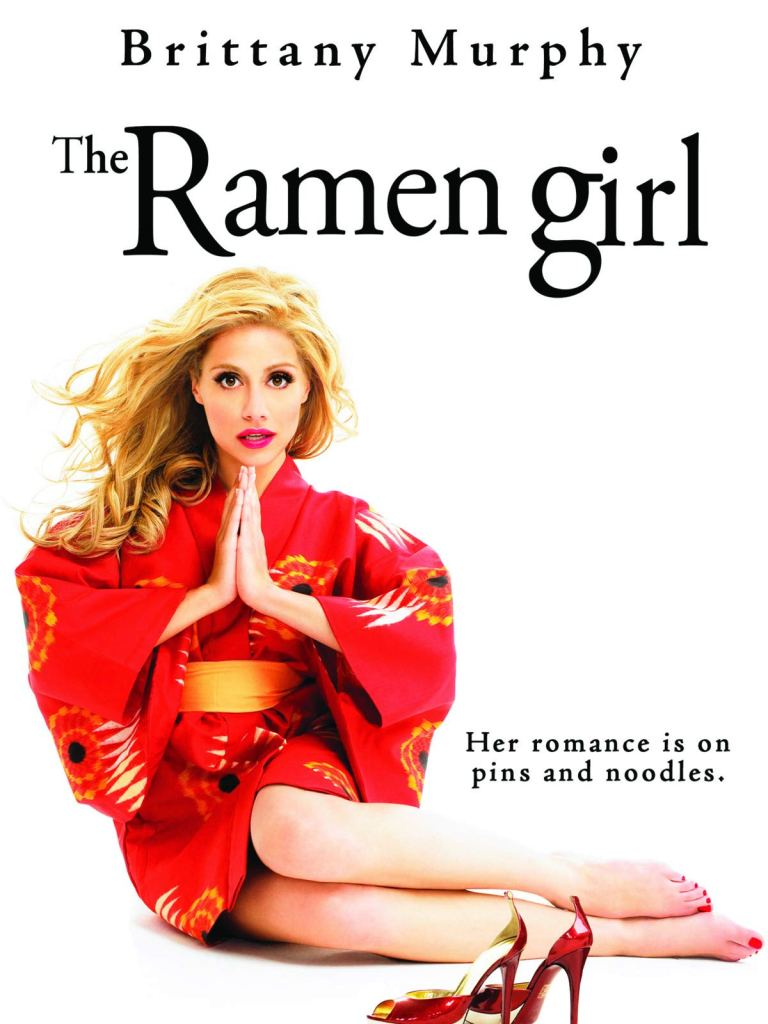 "Photo Description: the Ramen Girl movie 2008 poster art has Brittany Murphy in a red kimono, with golden circular accents, and she has her hands in a praying posture with her red high heels set in front of her. The caption says ""her romance is on pins and noodles."""