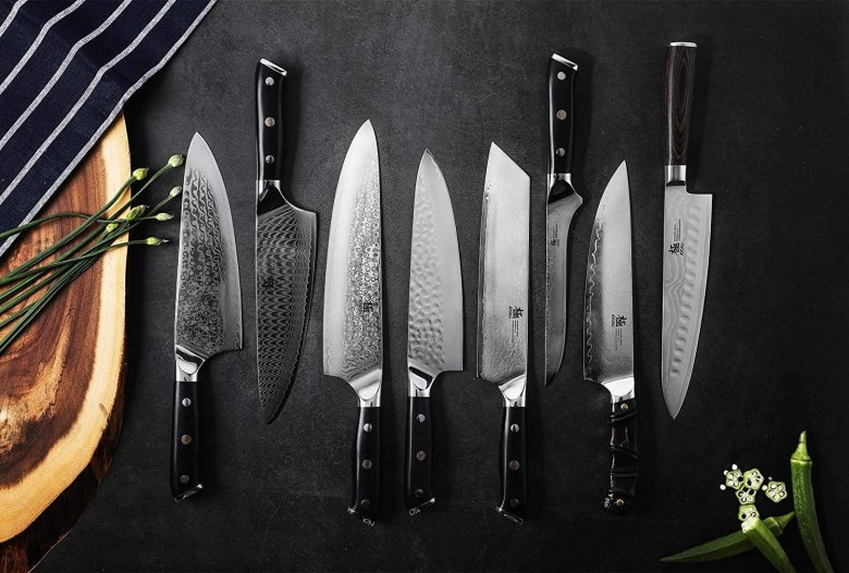 Photo Description: a lot of these product shots look the same. They are all on a dark background with the blades lit to contrast against it. The blades have a variety of finishes to them from dimpling, a Damascus look, to a ripple pattern. Also, it is a variety of knife styles but most look like kitchen knives. Kyoku knives has their logo on it.