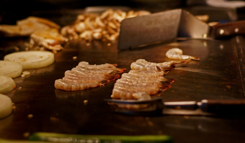Photo Description: a shot of the teppan which is a steel griddle a lot like the ones you would find in any diner.