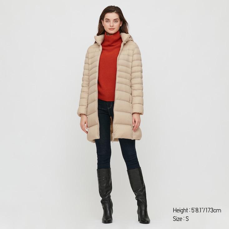 Photo Description: a beige hooded down jacket.