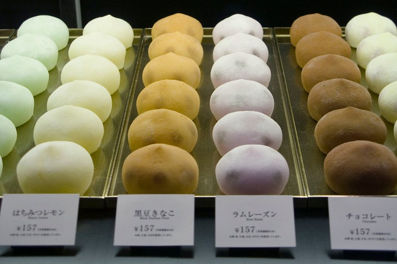 Photo Description: almost perfectly uniformly shaped mochi ice cream in Japan. The colors range from green, white, light brown, light purple, to dark brown.