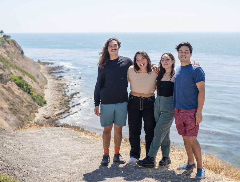 Photo Description: The Ito family. The Riviera Seafood Club is a family owned and operated business (4 kids). The family is pictured next to the ocean atop a trail.