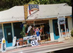Neal Mashburn standing in front of his surf shop, Beatched, on N. Ventura Avenue (AKA; Highway 33) in Oak View, California. Photo circa 1998.