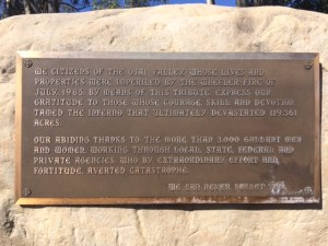 "This bronze plaque is attached to a large boulder that was placed on the north side of the ""Y"" intersection."