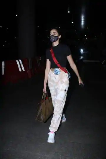 Masked Ananya Panday returns from Dubai decked in limited edition Louis Vuitton worth over Rs 4 lakh, Rs 3k Playboy joggers. SEE PICS