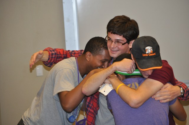 Matthew, Ben, Will, and Sameer celebrate after their victory in the Semi-FInals.
