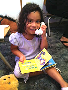 Young Girl playing with toy phone