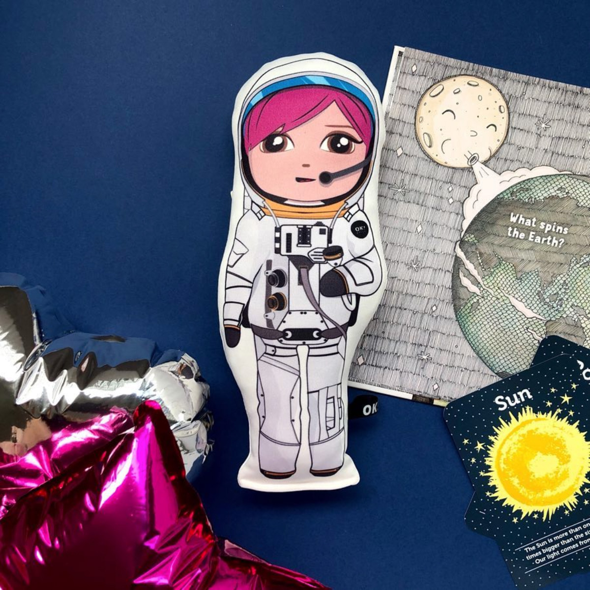 Amber Astronaut doll on navy background