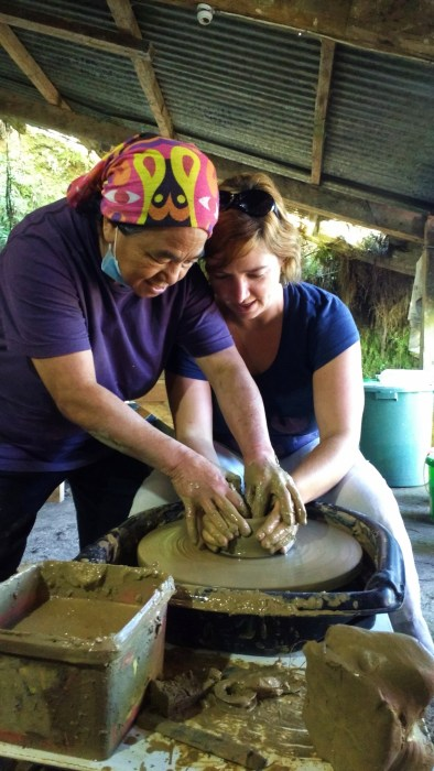Throwing a pot at Sagada Pottery.