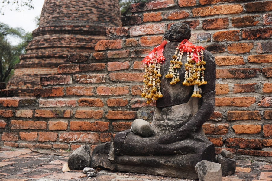 Wat Phra Ram with a headless buddha in Ayutthaya, Thailand.