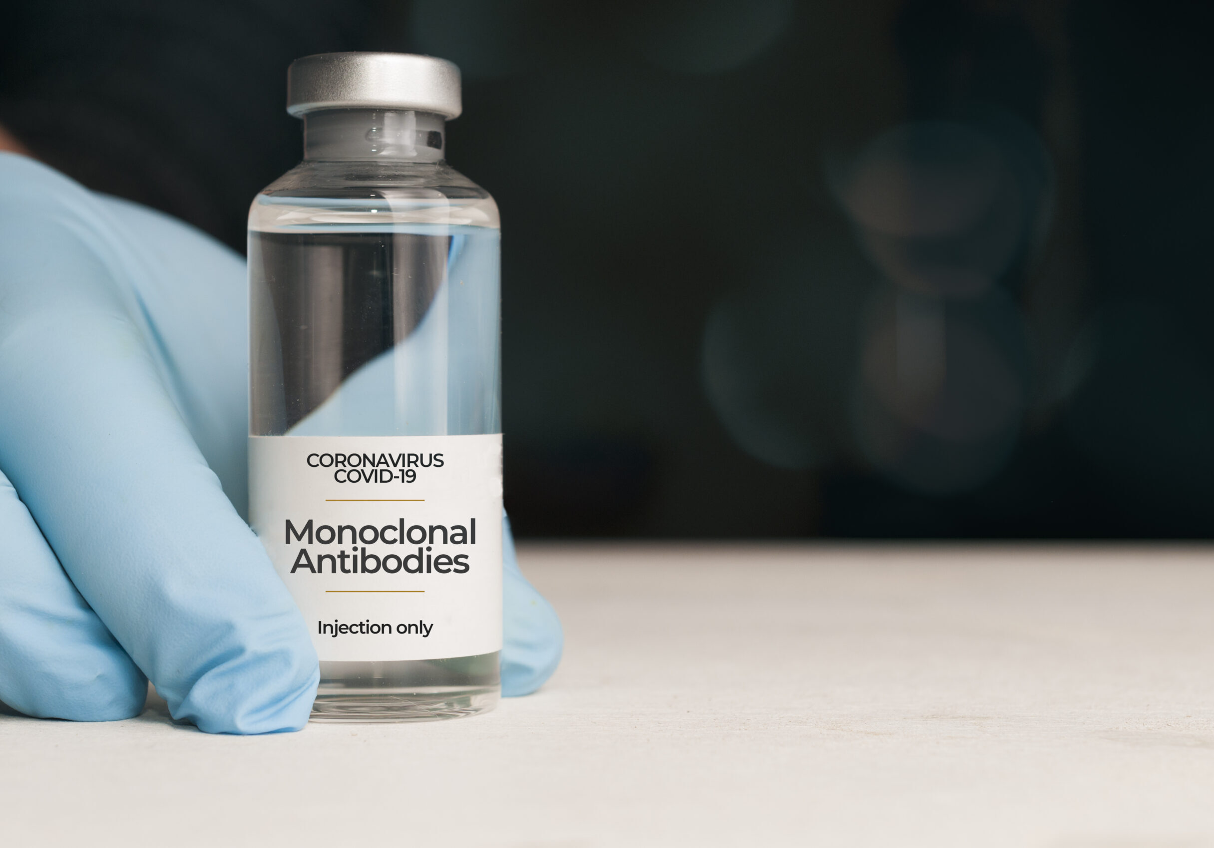 Doctor hold a vial of monoclonal antibodies , a new treatment for coronavirus Covid-19, on a white table