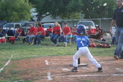 Our son, Rylan, swinging for the fences at his baseball game.