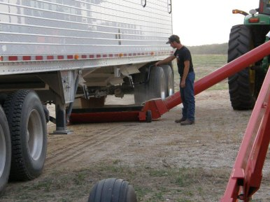 Clayton unloading and augering wheat into the bins.