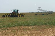 A row-crop planter and center pivot.