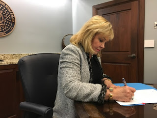 Fallin signs hotel/motel tax repeal, opposes removing capital gains exemption